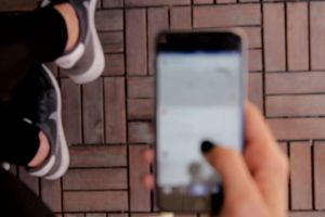 social media sneakers hand smartphone screen instagram