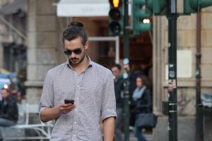 standing smartphone people fashion street texting shades road man