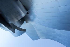 steel wave blue sky mirror design architectural design
