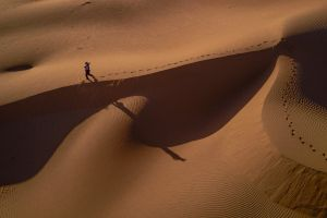 still life walking sand dunes scenic sand footprint landscape sunset shadow person