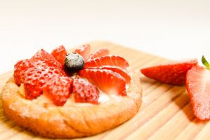 strawberries cake berries slices wooden board close-up delicious tasty fruits red