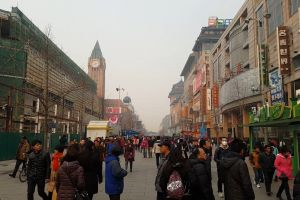 streets jackets signboards winter cold asia people