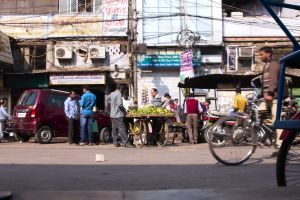 sunny road vehicles streets market people