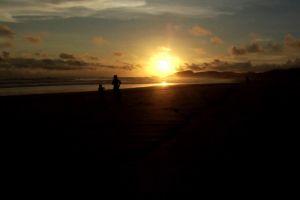 sunrise dawn dark ocean sea sunset shore water seashore scenic