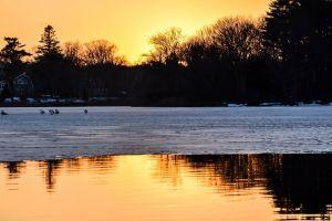 sunrise ice yellow orange reflections sunset new hampshire winter reflection