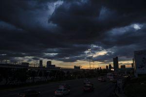 sunset city lights storm