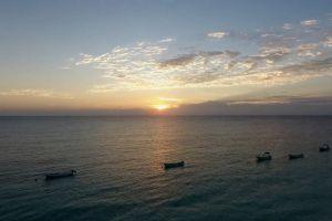 sunset ocean sea sunrise horizon sky water boats watercrafts