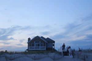 sunset people vacation sky guest fence dawn occasion sand clouds