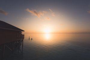 sunset scenic roof horizon sun swimming silhouetted evening water golden hour