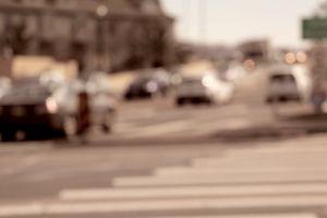 traffic blurred blurry pedestrian lane road cars crossing vehicles