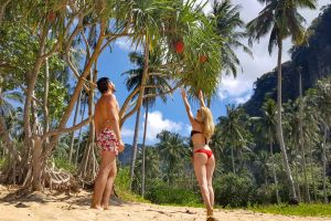 trees man clouds young couple people young swimsuit bikini travelers woman