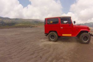 vehicle jeep bride sand automobile bromo sky drive transportation adventure