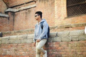 wall daylight sunglasses bricks pose stones fashion wear man style