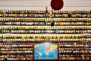 wall unusual alcohol bottles wooden shelves map bottles beer bottles inedited restaurant lamp
