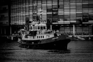 water daytime building transportation system boat black and white