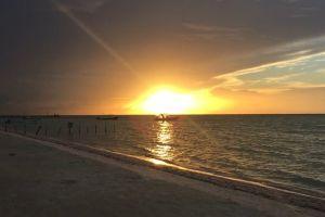 water watercraft sunset shore boats sand beach