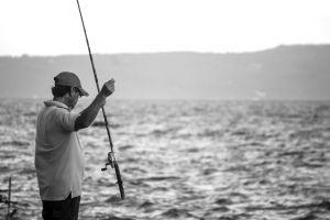 wave waveform blue fish fishing human fisherman fishing rod ocean water