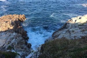 waves sea grass cliff rocks nature stream from above daylight high angle shot