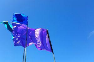 wind colour color clear sky sky flags blue sky