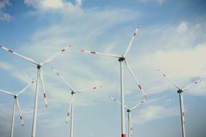 wind low angle shot windmills sky daylight energy