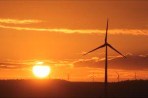 wind turbines sky sunset sun windmills