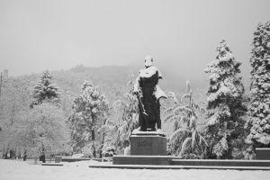 winter statue city park mountain snow fog