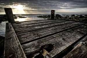 wood pier clouds ray of sunshine sunset sea hdr evening sun storm baltic sea