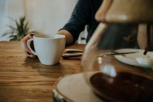 wood woman hand coffee chemex cup