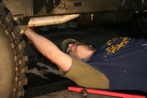 work greasy wrench below mechanic man under hobby automobile dirty