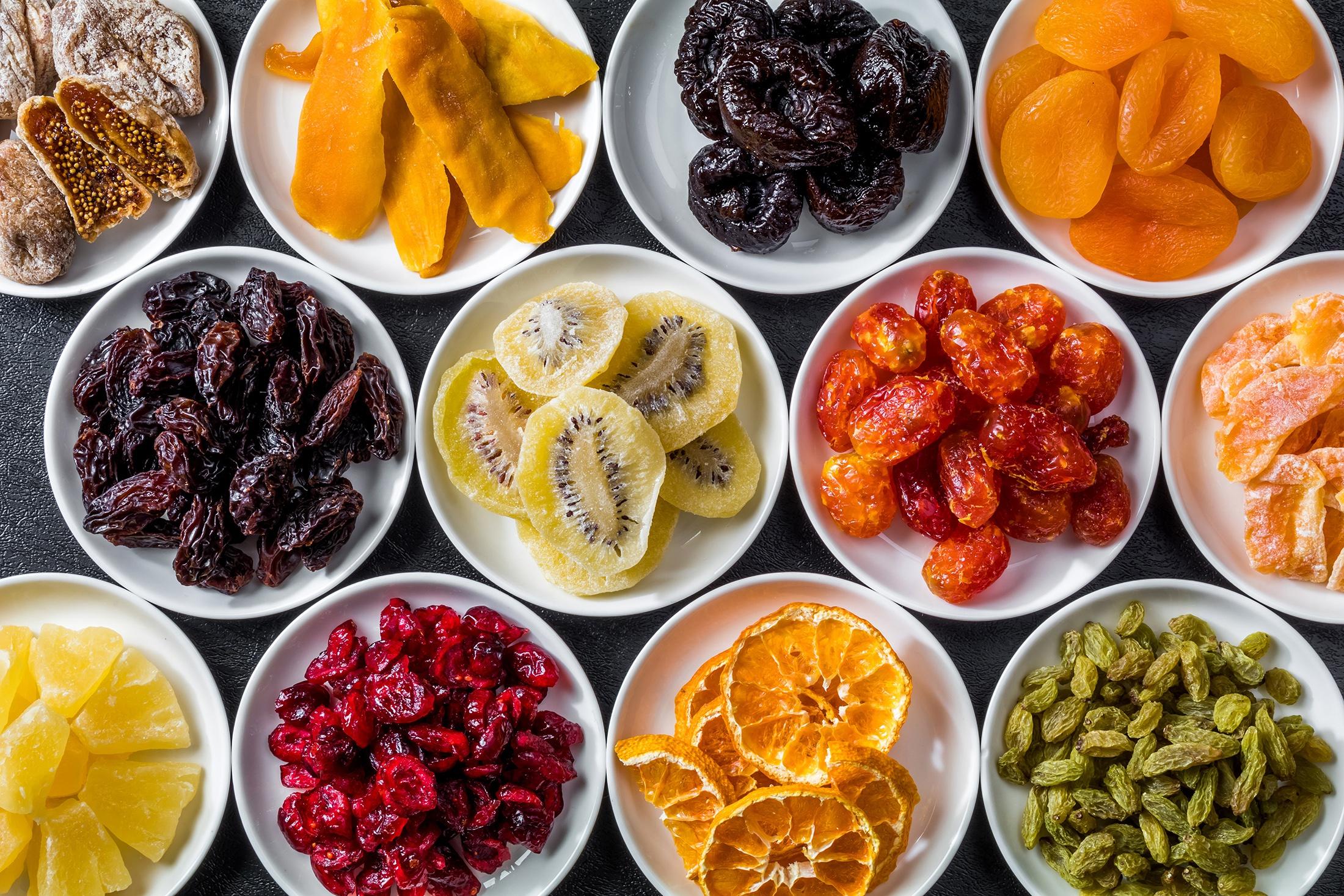 plums (fruits) colorful kiwi (fruit) food orange (fruit) fruit raisins