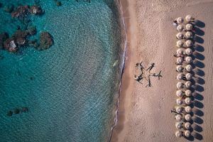 aerial view sand beach water people drone photo