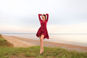 aleksey lozgachev outdoors barefoot women outdoors model long hair dress sky red dress brunette closed eyes beach hands on head horizon women