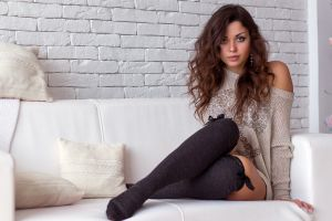 bare shoulders brunette model looking at viewer bricks long hair sweater socks women couch knee-highs wavy hair