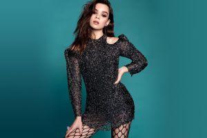 blue background actress women brunette hands on hips fishnet stockings hailee steinfeld dress