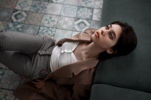 bokeh juliana naidenova on the floor model portrait blouses coats couch indoors gray eyes sitting brunette pants women indoors white blouse