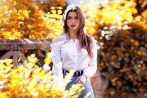 brown eyes women outdoors portrait women jeans leaves brunette bare shoulders eric vend long hair face sunlight white shirt