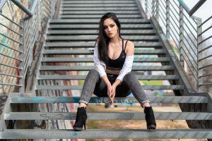 brunette sitting outdoors jeans stairs looking at viewer black tops depth of field makeup heels cleavage women long hair eyeliner women outdoors