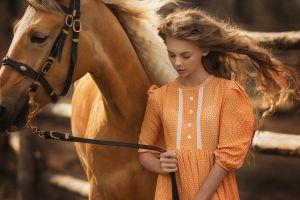 brunette wavy hair windy women outdoors closed eyes model women with horse orange dress women dress horse long hair animals