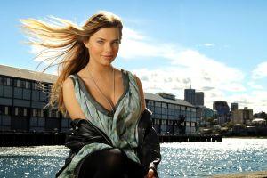 building windy actress indiana evans blue eyes smiling women black jackets clouds tank top singer necklace blonde long hair black stockings
