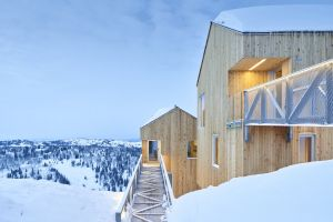 cabin snow covered snow modern architecture