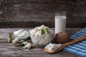 cheese food milk parsley bread spoon wooden surface