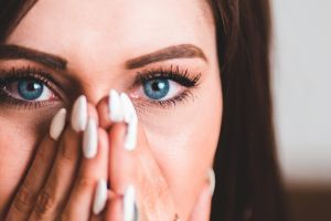 closeup face hands eyelashes women long nails depth of field model brunette blue eyes covering face looking at viewer