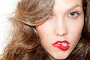 closeup face red lipstick blue eyes simple background biting lip model women karlie kloss