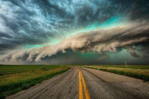 clouds road sky asphalt storm landscape