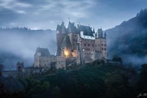 eltz castle clouds castle architecture ancient watermarked landscape tower nature forest germany mist trees