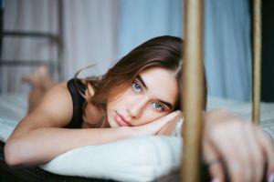 face blue eyes brunette long hair lying on front women indoors dima minakin portrait looking at viewer women