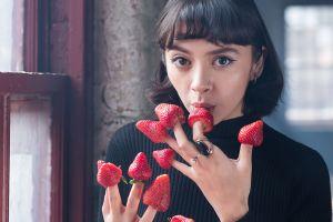 fingers short hair brown eyes pierced nose sweater face fruit women looking at viewer strawberries rings window brunette model