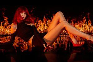 fire women indoors model red heels  redhead women burning legs