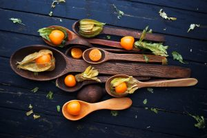 food spoon fruit wooden surface