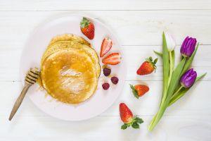 food wooden surface strawberries raspberries flowers fruit tulips berries pancakes honey